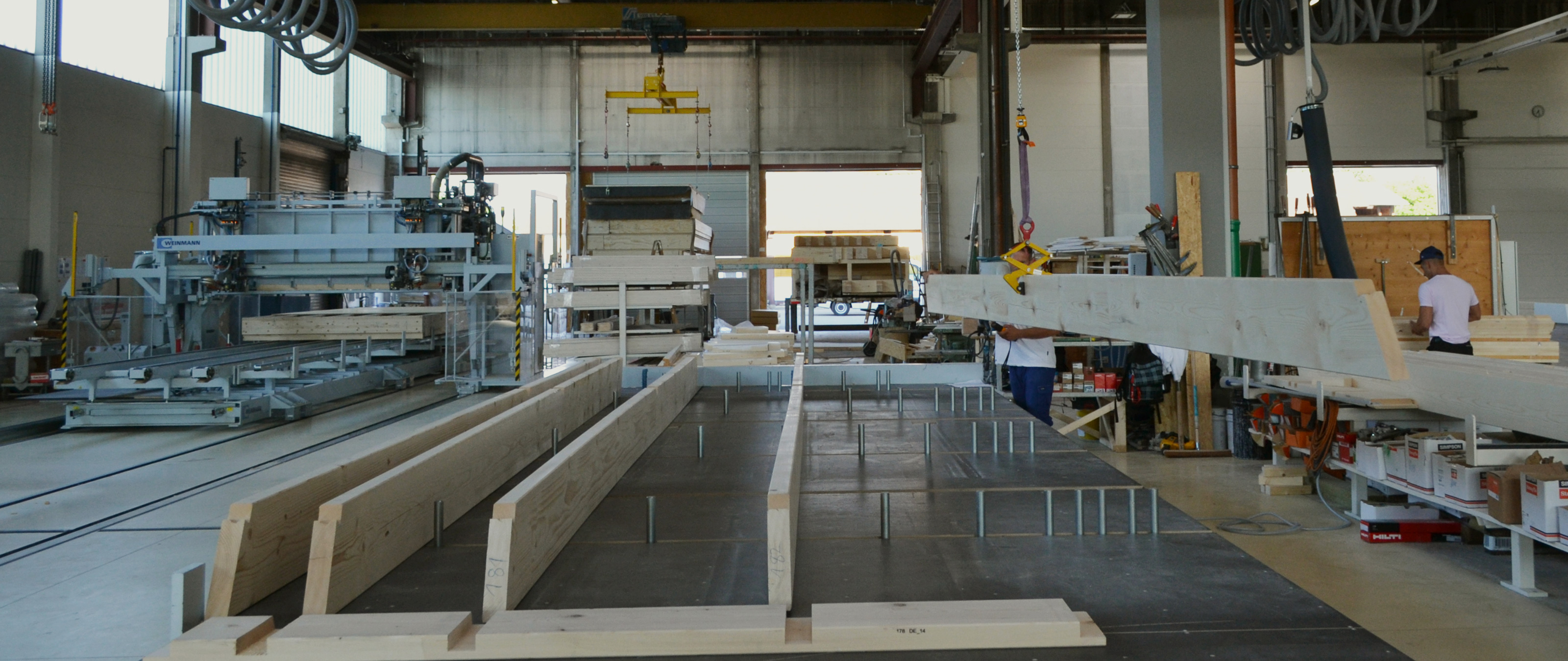 WEINMANN Roof and ceiling production line for prefabricated houses with nailing bridges and framingtables