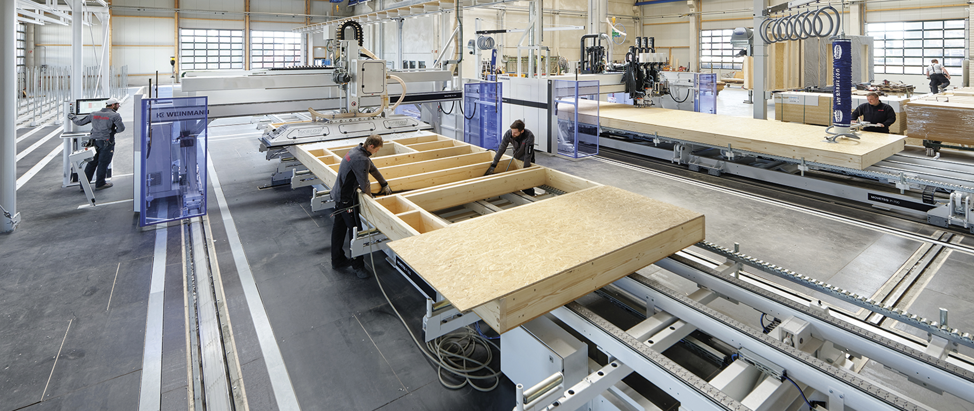 WEINMANN Wall production line for prefabricated houses with nailing bridges and framing tables